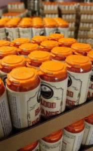fbc cans of blood orange wheat fresh off the line